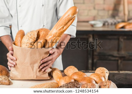 freshly baked bread in a paper bag copyspace consumerism shopping buying food service friendly job.