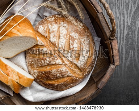 freshly baked bread in basket on dark gray kitchen table, top view,copy space #1468478930