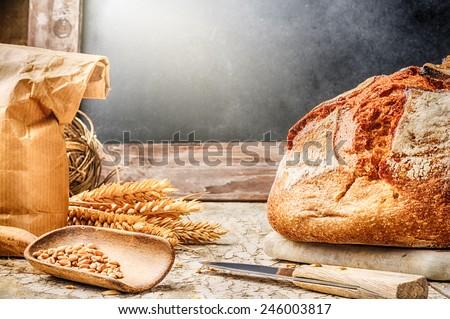 Freshly baked bread in rustic setting with copyspace on blackboard
