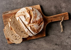 freshly baked bread on dark gray kitchen table, top view