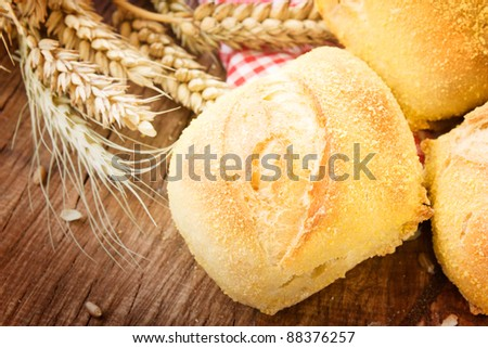 Freshly baked bread variety on wooden background