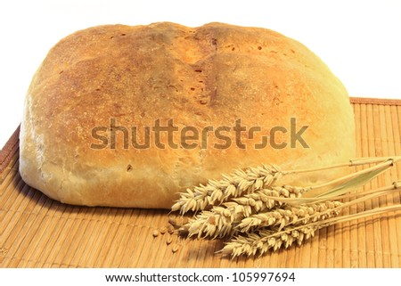 freshly baked bread with ears of wheat