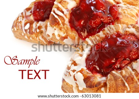 Freshly baked cherry danish pastries on white background with copy space.  Macro with shallow dof.