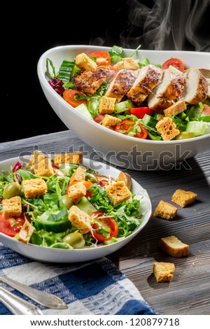 Freshly baked chicken and salad Caesar