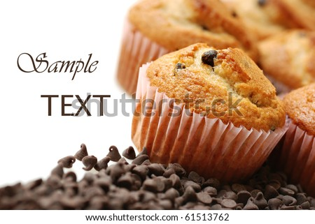 Freshly baked chocolate chip muffins on white background with copy space.  Macro with shallow dof.