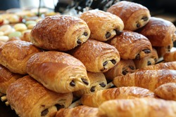 Freshly baked Chocolate filled croissants for sale at street market