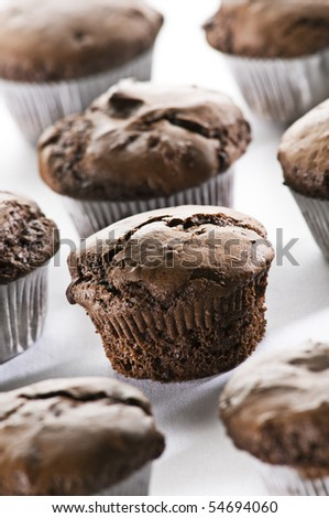 Freshly baked chocolate muffins close up shoot