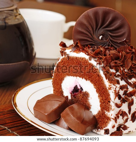 Freshly Baked Chocolate Roll Cake with pieces of chocolate