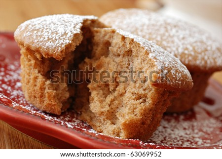 Freshly baked cinnamon spice muffin sprinkled with powdered sugar.  Macro with extremely shallow dof. #63069952