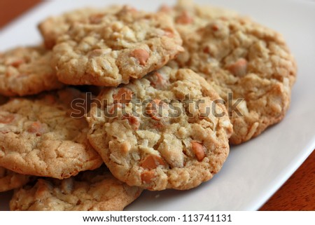 Freshly baked cookies stacked on a white plate. - stock photo