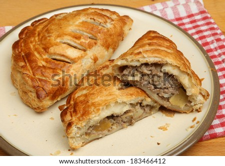 Freshly baked Cornish pasties on a plate