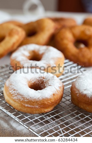 Freshly baked doughnuts sprinkled with icing sugar