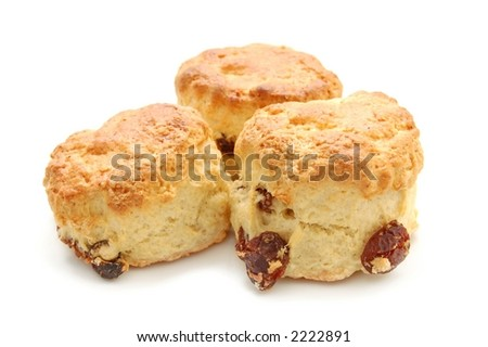 Freshly baked fruit scones, isolated over white, macro