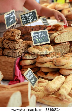 Freshly baked gourmet breads for sale in an outdoor French market