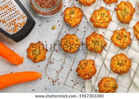 Freshly baked homemade carrot cookies with flax seed and pumpkin seeds close-up. Delicious and healthy vegetarian snack. Selective Focus