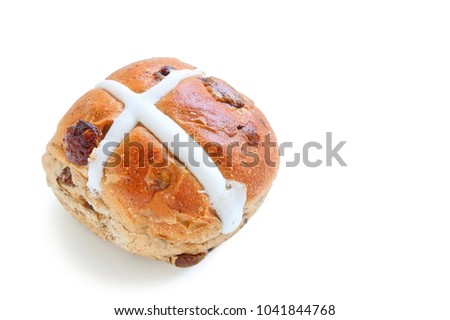 Freshly Baked Hot Cross Bun on White Background #1041844768