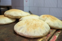 Freshly baked israeli flat bread pita close-up