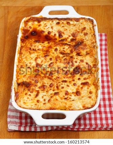 Freshly baked lasagna in casserole dish