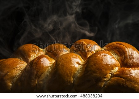 Freshly baked loaf of Challah bread, hot and steaming