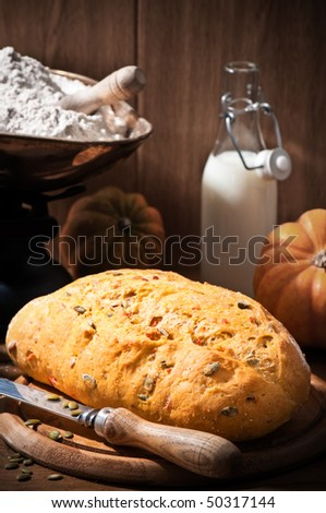 Freshly baked loaf of pumpkin bread in farmhouse setting - stock photo