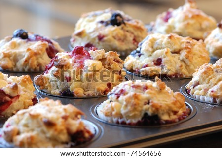 Freshly baked muffins with mixed berries and white chocolate