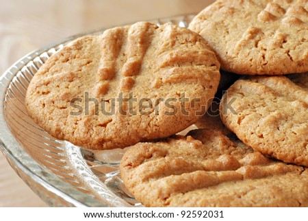 Freshly baked peanut butter cookies on crystal plate.  Macro with shallow dof.