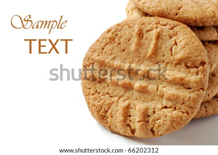Freshly baked peanut butter cookies on white background with copy space.  Macro with shallow dof.