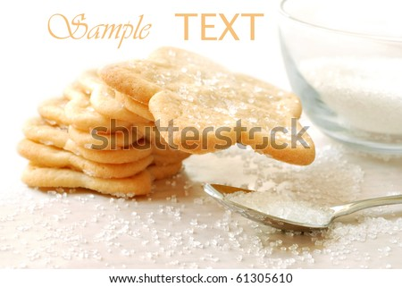 Freshly baked star shaped sugar cookies with decorating sugar on white background with copy space.  Macro with shallow dof.