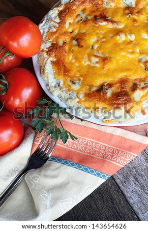 Freshly baked tomato pie with tomatoes on the vine.