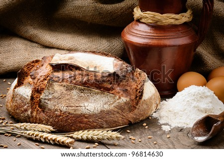 Freshly baked traditional bread in a countryside set