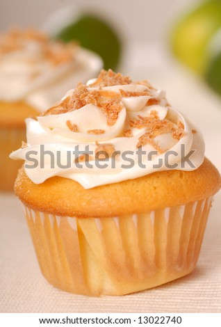 Freshly baked vanilla cupcake with lemon buttercream and toasted coconut
