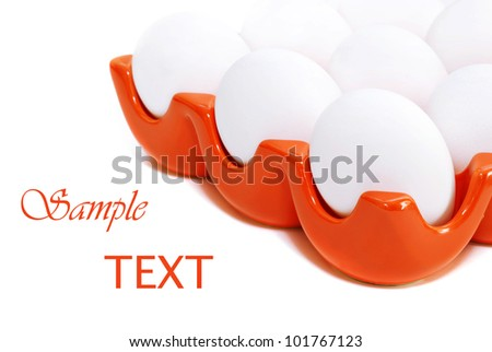 Freshly boiled eggs in orange ceramic tray on white background with copy space.  Macro with shallow dof.