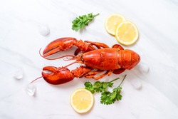 freshly boiled red lobster with ice and lemon