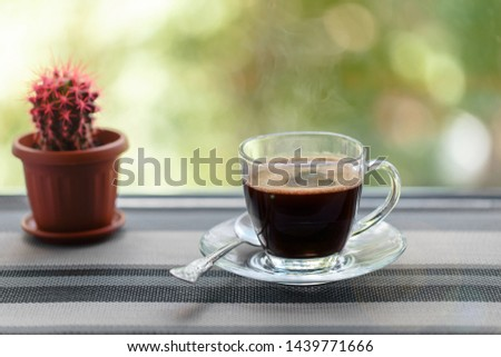 Freshly brewed morning coffee in a Cup, prepared for Breakfast. For good mood and good morning.