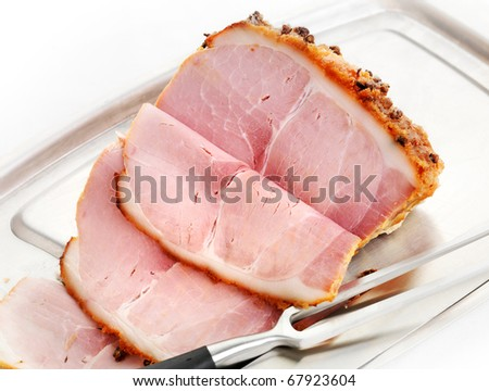Freshly carved Honey Roast Ham with cloves and brown sugar coating