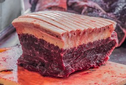 Freshly caught Minke Whale for Sale at a Butcher in Nuuk, Greenland. This is a seasonal delicacy, strictly regulated by a government quota system.