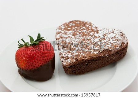 Freshly Chocolate  Dipped Strawberry With Heart Shaped Cake - stock photo