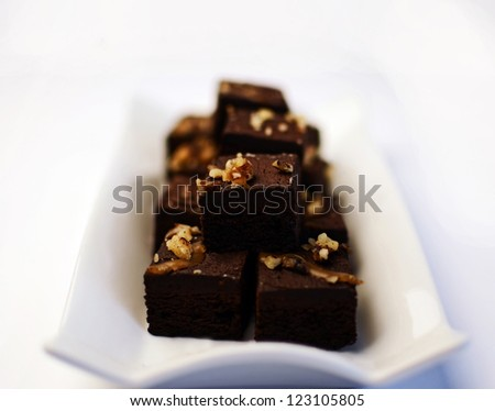Freshly cooked brownies on a white place