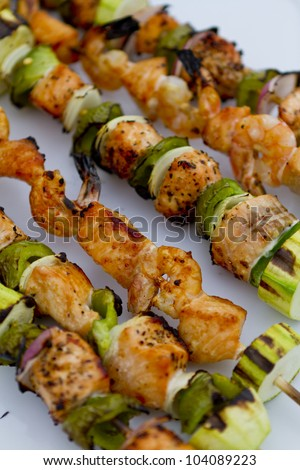 Freshly cooked salmon fish kebabs on the plate ready to eat.