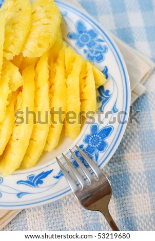 Freshly cut pineapple fruit slices signifying diet and nutrition, food and beverage, and healthy eating concepts.