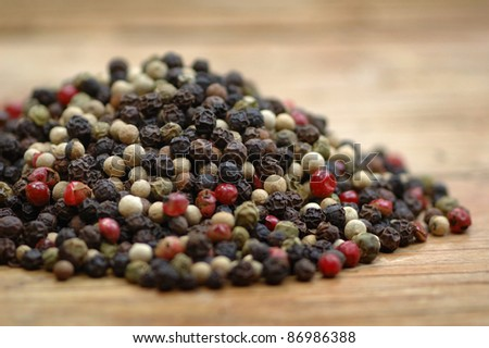freshly dried peppercorn on wooden table