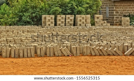 Freshly formed bricks are in a yard. Brick manufacturing in developing countries.