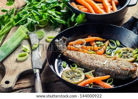 Freshly fried fish with lemon and parsley #144000922