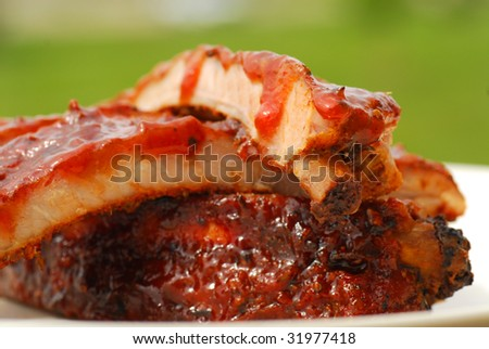 Freshly grilled BBQ spare ribs with a tangy BBQ sauce