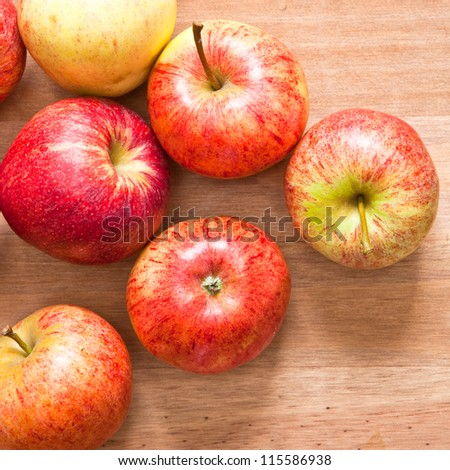 Freshly harvested apples on a wooden table
