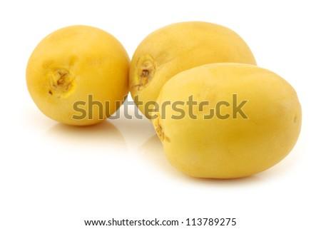 freshly harvested dates (Phoenix dactylifera) on a white background
