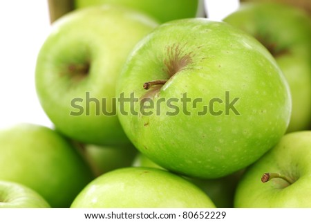"freshly harvested ""Granny Smith"" apples in a wooden crate on a white background"
