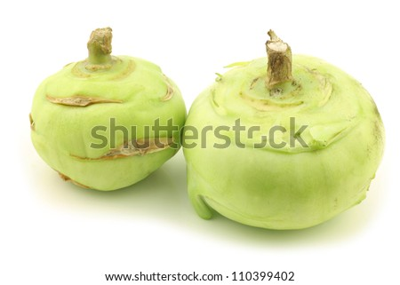 freshly harvested kohlrabi cabbages on a white background