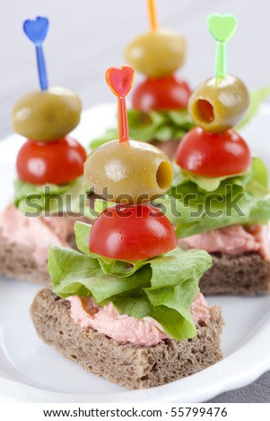 Freshly made bites of lettuce, olives and cherry tomatoes