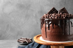 Freshly made delicious chocolate cake on grey background